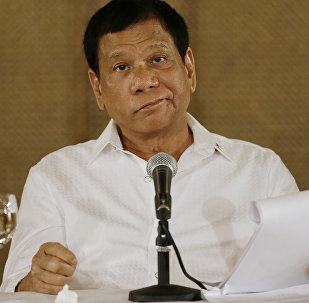 In this Monday, March 13, 2017 file photo, Philippine President Rodrigo Duterte reacts during a press conference at the Malacanang presidential palace in Manila, Philippines.