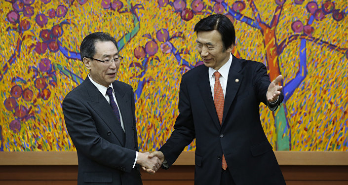 (File) Chinese chief nuclear envoy Wu Dawei (L) is greeted by South Korea's Foreign Minister Yoon Byung-se (R) during his visit to the Foreign Ministry in Seoul on February 29, 2016