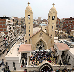 A general view is seen as Egyptians gather by a Coptic church that was bombed on Sunday in Tanta, Egypt, April 9, 2017