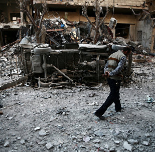 Men inspect damage after an airstrike on the rebel held besieged city of Douma, in the eastern Damascus suburb of Ghouta, Syria April 7, 2017