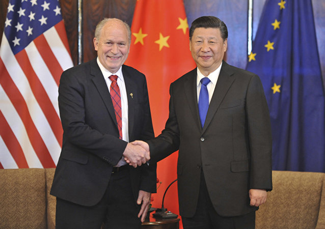 Chinese President Xi Jinping, right, and Alaska Governor Bill Walker greet each other at a meeting Friday, April 7, 2017, in Anchorage, Alaska