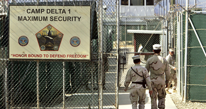 US military guards walk within Camp Delta military-run prison, at the Guantanamo Bay US Naval Base, Cuba. File photo