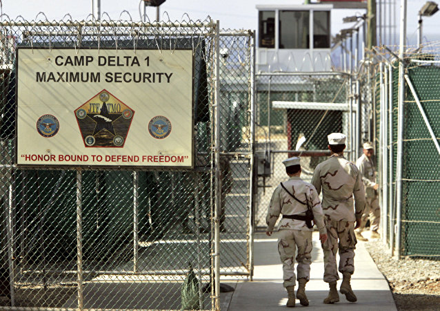 U.S. military guards walk within Camp Delta military-run prison, at the Guantanamo Bay U.S. Naval Base, Cuba