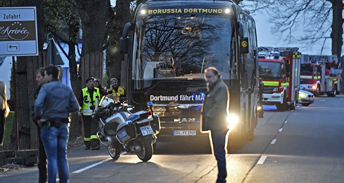A window of Dortmund's team bus is damaged after an explosion before the Champions League quarterfinal soccer match between Borussia Dortmund and AS Monaco in Dortmund, western Germany, Tuesday, April 11, 2017