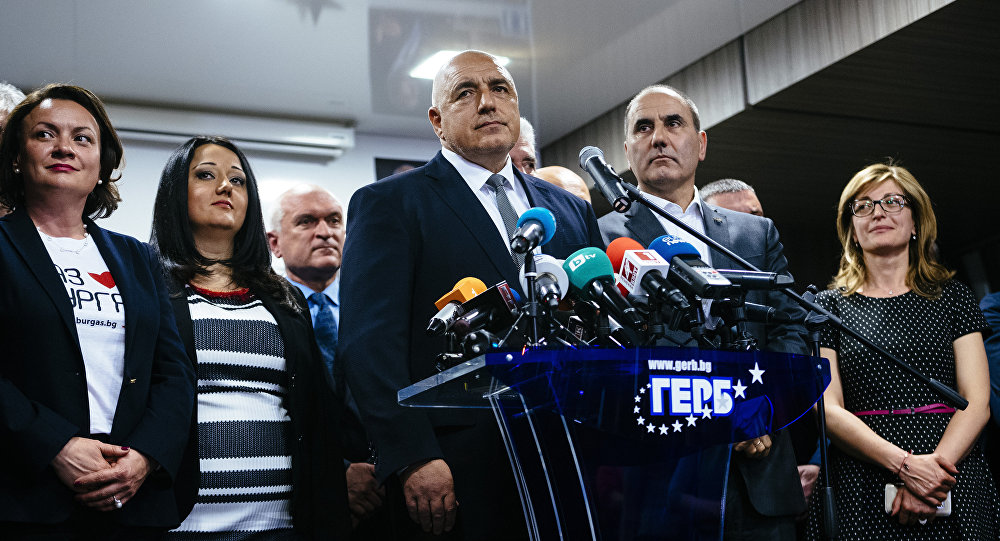 Head of the centre-right GERB party and former prime minister Boyko Borisov (C) speaks to media in Sofia on March 26, 2017, after his party won the country's parliamentary election