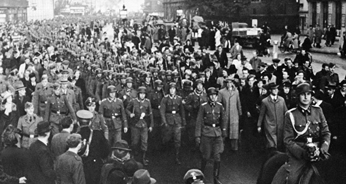 The Danish legion of pro-Nazis who are fighting with the Germans on the Russian front leaving Copenhagen after spending their leave there, Nov. 12, 1942