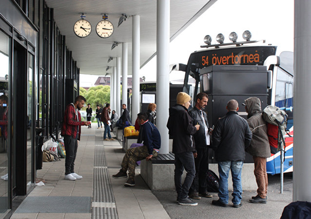 Migrants wait for a bus in Sweden (photo used for illustration purpose only)