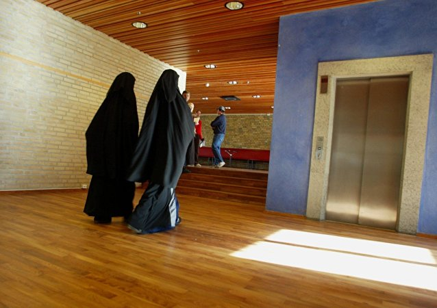 Two Muslim girls with burqas walking inside the Burgarden secondary school in the town of Gothenburg in western Sweden  (file)