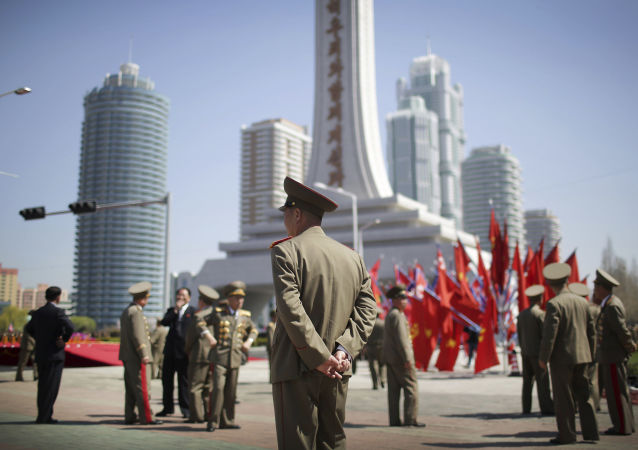 North Korean military soldiers walk along the Ryomyong residential area, a collection of more than a dozen apartment buildings just after attending its official opening ceremony on Thursday, April 13, 2017, in Pyongyang, North Korea. (AP Photo/Wong Maye-E)