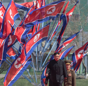 DPRK leader Kim Jong-il, center, at a ceremony to open a new residential area on Ryomyong Street in Pyongyang.