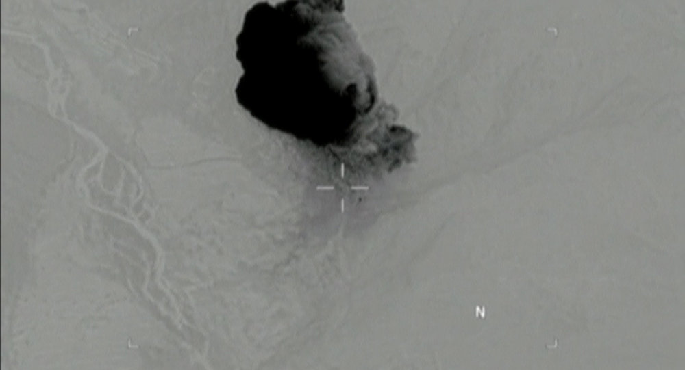 Still image taken from a video released by the U.S. Department of Defense on April 14, 2017 shows the moment the mother of all bombs struck the Achin district of the eastern province of Nangarhar, Afghanistan