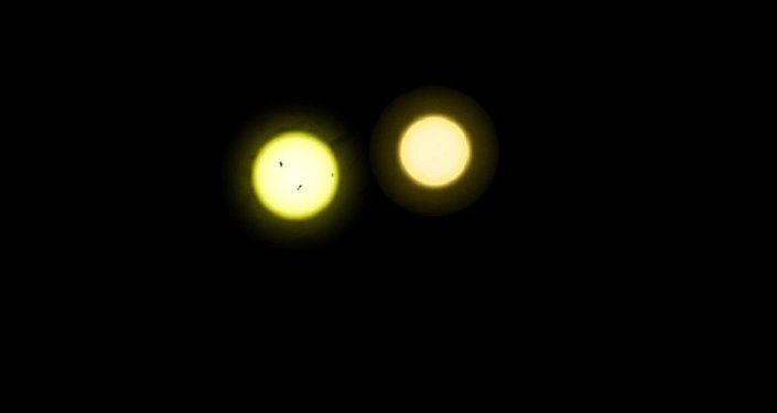 The Sun (left) is both larger and somewhat hotter than the less active Tau Ceti (right)