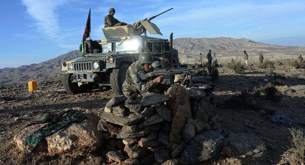 In this photograph taken on December 3, 2016, Afghan security forces take positions following an operation against DAESH militants in Pachir Wa Agam district of Nangarhar province.