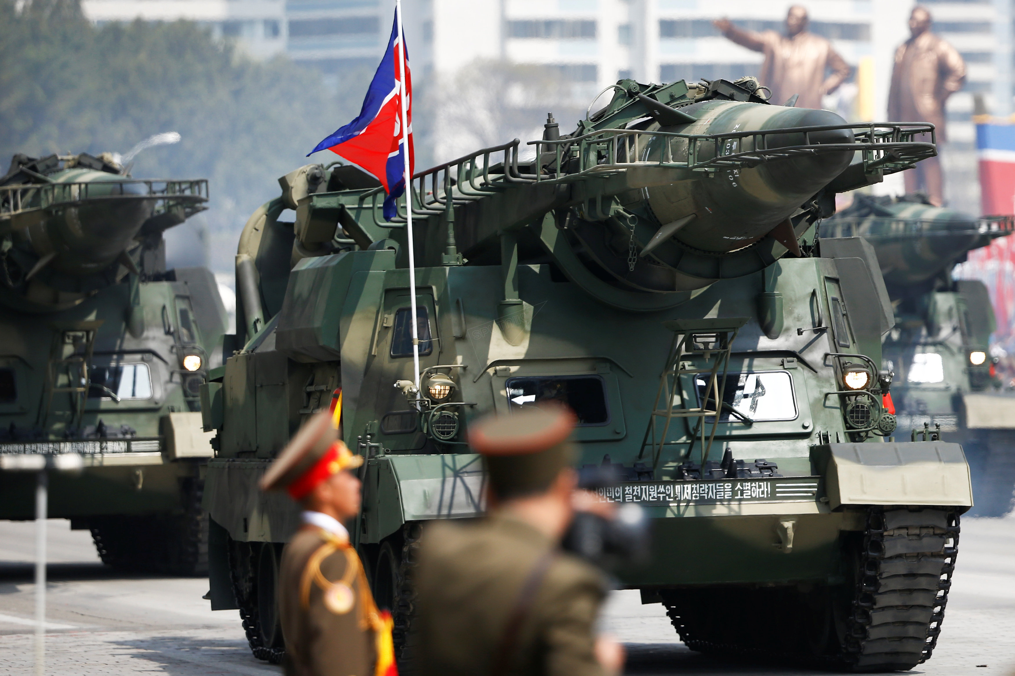 Missiles looking similar to Soviet Scud-As are driven past the stand with North Korean leader Kim Jong Un and other high ranking officials during a military parade in Pyongyang, April 15, 2017.