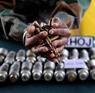 Indian army officials display arms and ammunition at Handwara in north Kashmir some 80 km from Srinagar on May 9,2011