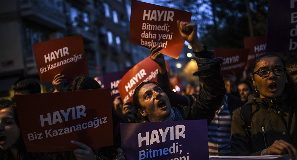A supporter of the No gestures and chants slogans as he holds a placard reading No during a march at the Kadikoy district in Istanbul on April 17, 2017 to protest following the results in a nationwide referendum that will determine Turkey's future destiny