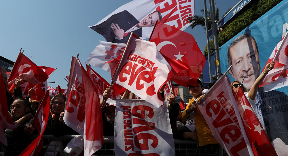 Supporters of Turkish President Tayyip Erdogan wave Turkey's national flags and Yes campaign flags during a rally for the upcoming referendum in Istanbul, Turkey, April 15, 2017