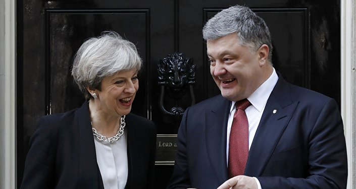 Britain's Prime Minister Theresa May greets Ukrainian President Petro Poroshenko in Downing Street in central London Britain