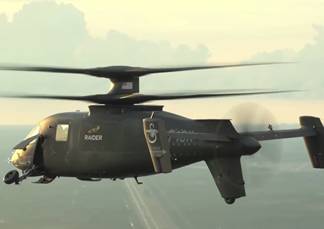 The S-97 Raider, Sikorsky's newest light tactical helicopter, withdrawing its landing wheels during a video demonstration.