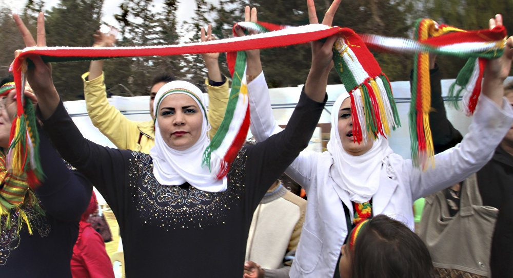 Syrian Kurds dance to celebrate Nowruz, the Kurdish new year, in Damascus, Syria. (File)