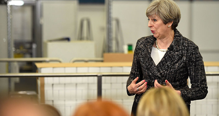 Britain's Prime Minister, Theresa May, addresses staff at a GlaxoSmithKline toothpaste factory in Maidenhead, April 21, 2017.