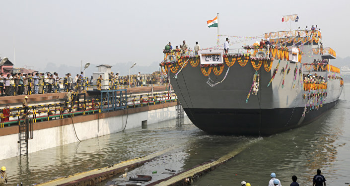 A Landing Craft Utility (LCU) ship rolls into the Ganges River as workers watch during its launching ceremony in Kolkata, India. (File)