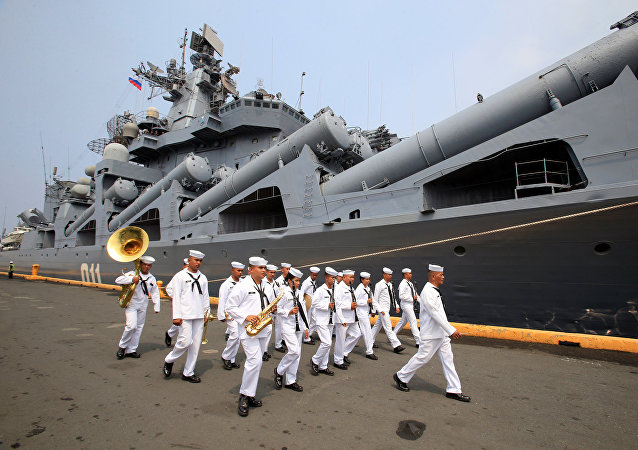 The Philippine Navy's band marches in front of the Russian Navy's guided missile cruiser Varyag, docked during a goodwill visit, at Pier 15, South Harbor, Metro Manila, Philippines April 20, 2017.