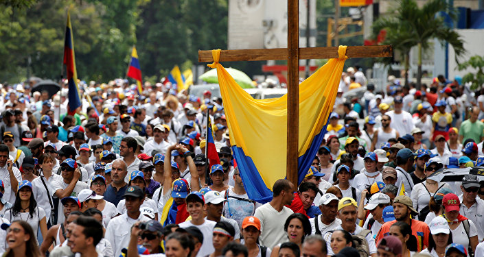 Demonstrators take part in a rally to honour victims of violence during a protest against Venezuela's President Nicolas Maduro's government in Caracas, Venezuela