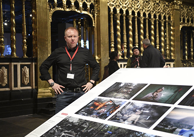 Valery Melnikov, Sputnik photojournalist and winner of multiple leading international photography contests at 2017 World Press Photo exhibition.
