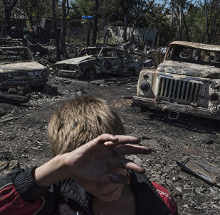 Burned cars after shelling of the Lozovoe village in Donetsk.