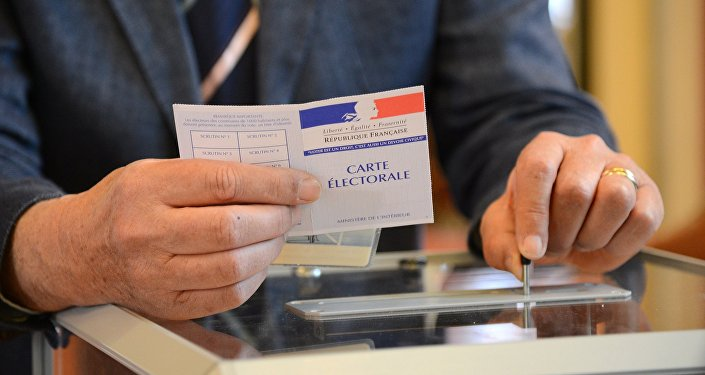 A man votes at a polling station in Paris in the first round of the French presidential election