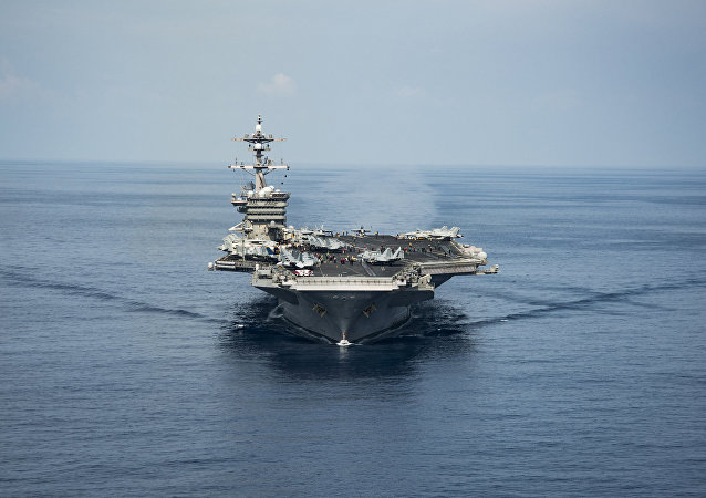 The aircraft carrier USS Carl Vinson transits the South China Sea while conducting flight operations on April 9, 2017.