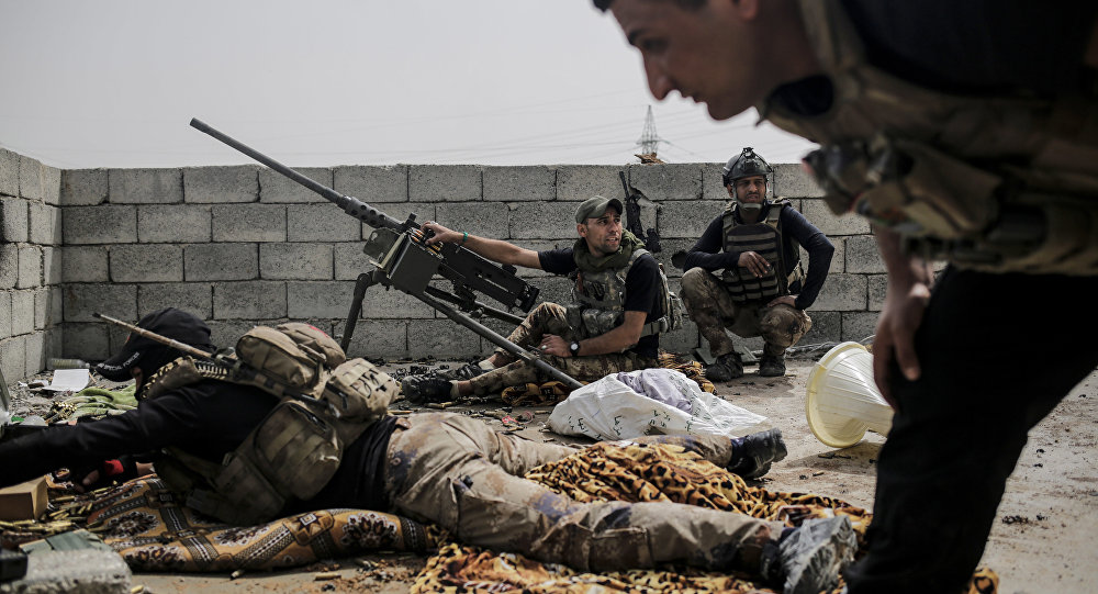 Soldiers with the Iraqi special forces look out on Islamic State group positions from a rooftop in west Mosul as fighting continues, Monday, April 24, 2017