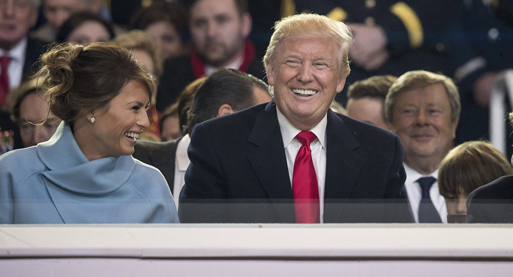 President Donald Trump shares a laugh with first lady Melania Trump and son Barron Trump as they sit in the reviewing stand during Trump's inaugural parade on Pennsylvania Ave. outside the White House in Washington, Friday, Jan. 20, 2017