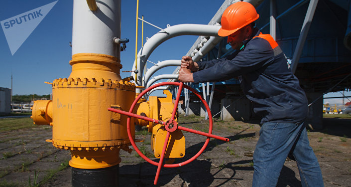 An employee tightens the valve on a pipeline at the Bilche-Volytsko-Uherske underground gas storage facility.