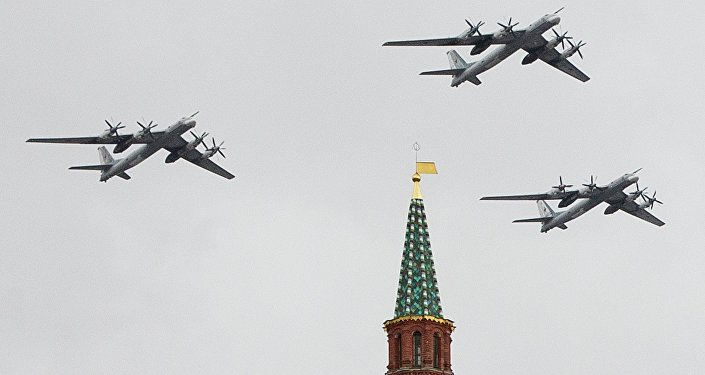 Russian Air Force strategic bombers, Tu-95, fly in formation over Red Square.