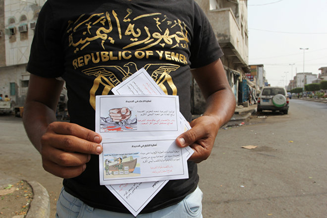 A man displays leaflets dropped by Saudi-led coalition's air force on the Red Sea port city of Hodeidah, Yemen April 26, 2017. The leaflets read: Our forces of legitimacy are heading to liberate Hodeidah and end the suffering of our gracious Yemeni people. Join your legitimate government in favor of the free and happy Yemen!