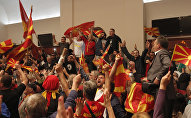 Protestors shout after entering into the parliament building in Skopje, Macedonia, Thursday, April 27, 2017.