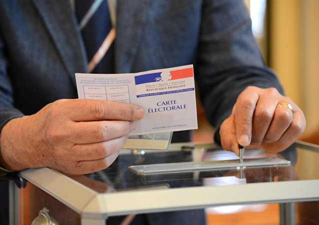 Voting during the first round of France's presidential election at a polling station in Le Touquet commune of the Pas-de-Calais department. File photo