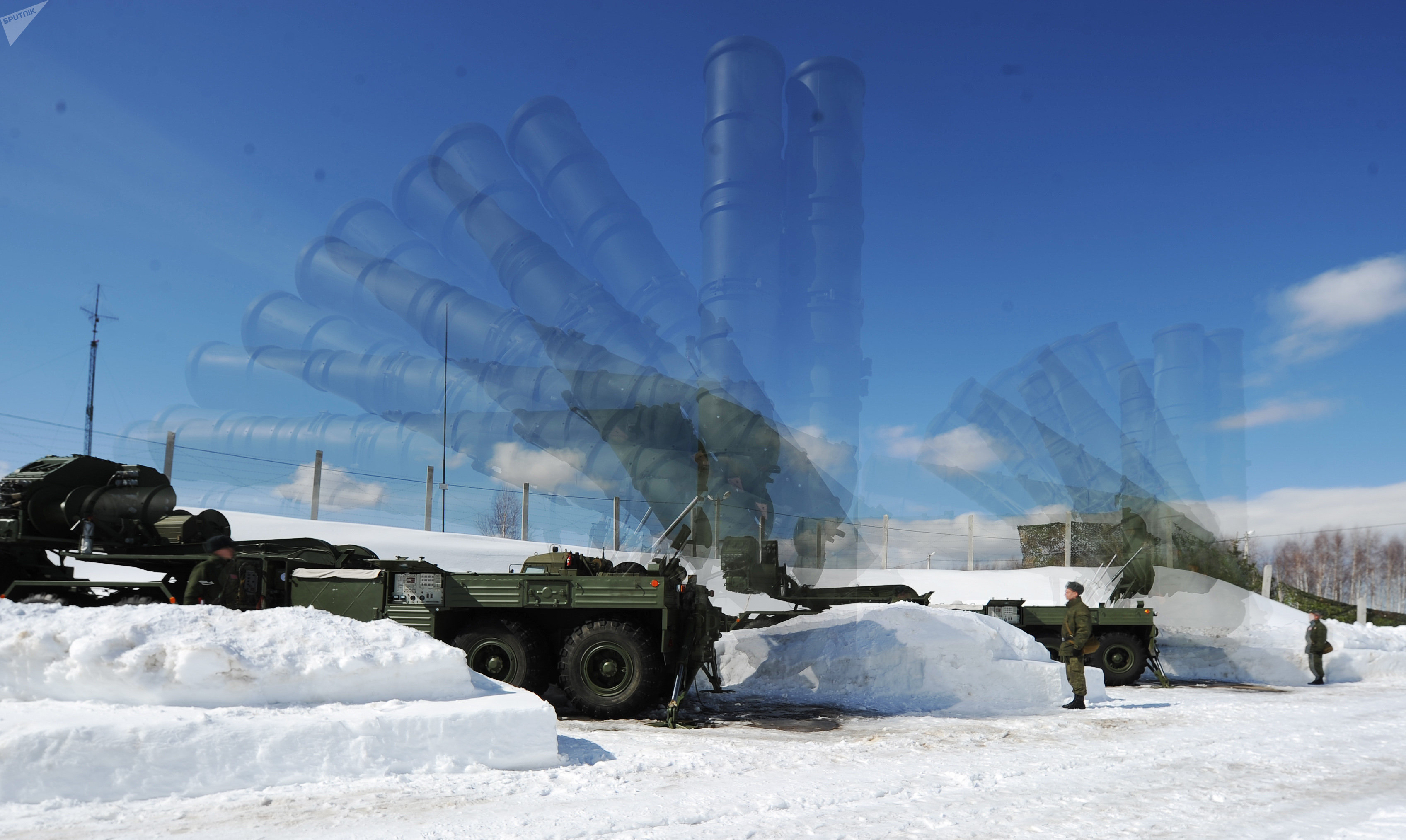Soldiers of the 4th Brigade Air Defense (NORAD) air and space defense forces (ASD) during the deployment of the Launcher antiaircraft missile system S-400 Triumph at a site in the Moscow region. Multi exposure.