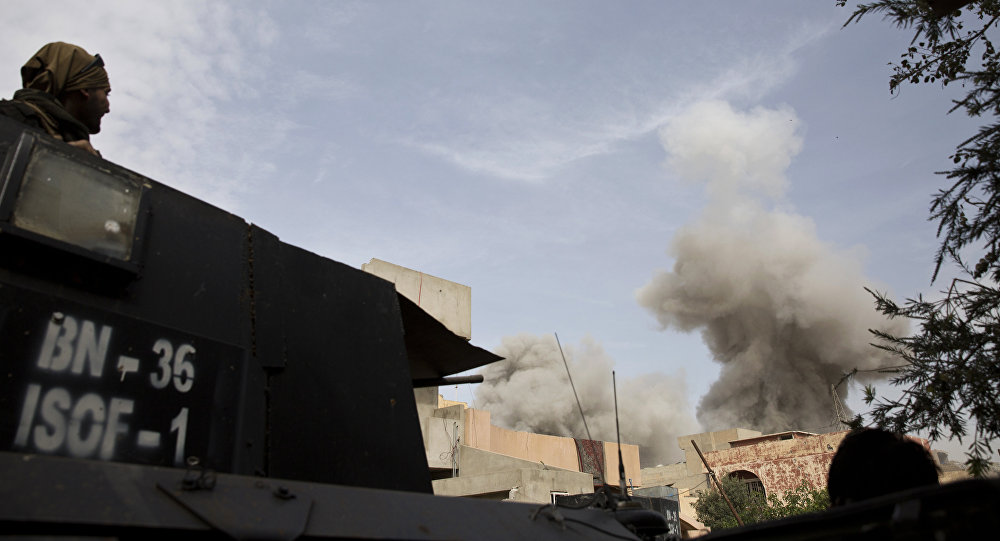 An Iraqi special forces soldier watches the plume of smoke from a coalition airstrike on a car bomb as troops move from the Yarmouk neighborhood to take another district from Islamic State militant control in Mosul, Iraq, Wednesday, April 12, 2017