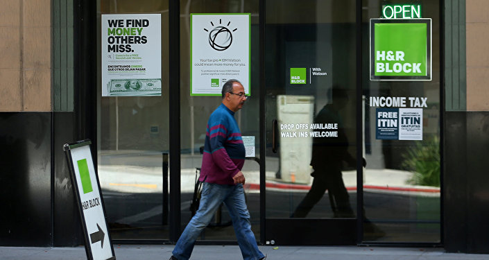 A pedestrian walks past a H&R Block tax office in Los Angeles, California, U.S., April 26, 2017