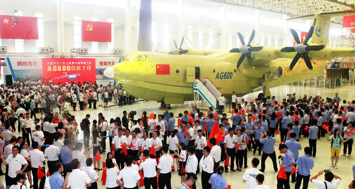 This picture taken on July 23, 2016 shows a crowd at a ceremony to unveil the AG600 amphibious plane in Zhuhai, in south China's Guangdong Province.