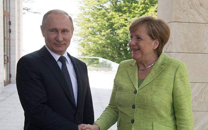 sputniknews.com - Putin, Merkel Discussed Overcoming Negative Trends on World Financial Markets