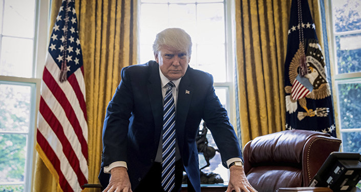 In this April 21, 2017, file photo, President Donald Trump poses for a portrait in the Oval Office in Washington after an interview with The Associated Press.