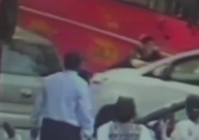 A Mumbai police officer runs down a pedestrian with his car over a financial dispute.