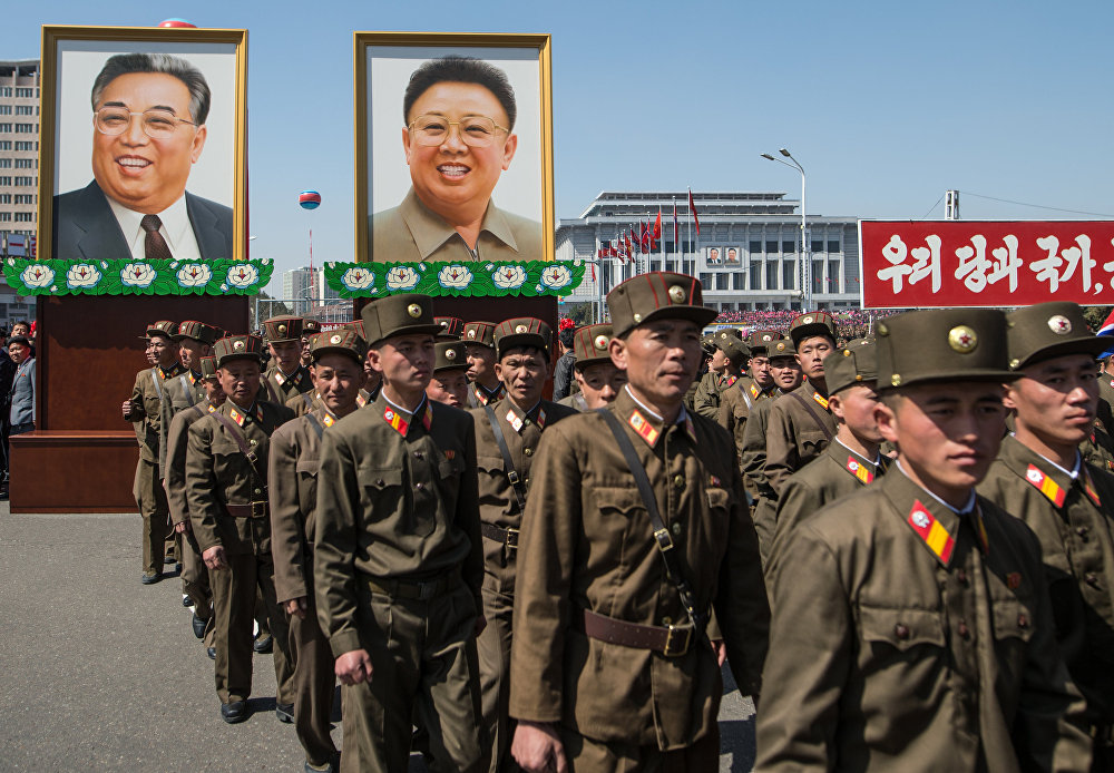 Portraits of Kim Il-sung and Kim Jong-il at a ceremony to open a new residential area on Ryomyong Street in Pyongyang.