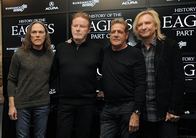 In this Jan.19, 2013 file photo, from left, Timothy B. Schmit, Don Henley, Glenn Frey and Joe Walsh of The Eagles pose together after a news conference in Park City, Utah.