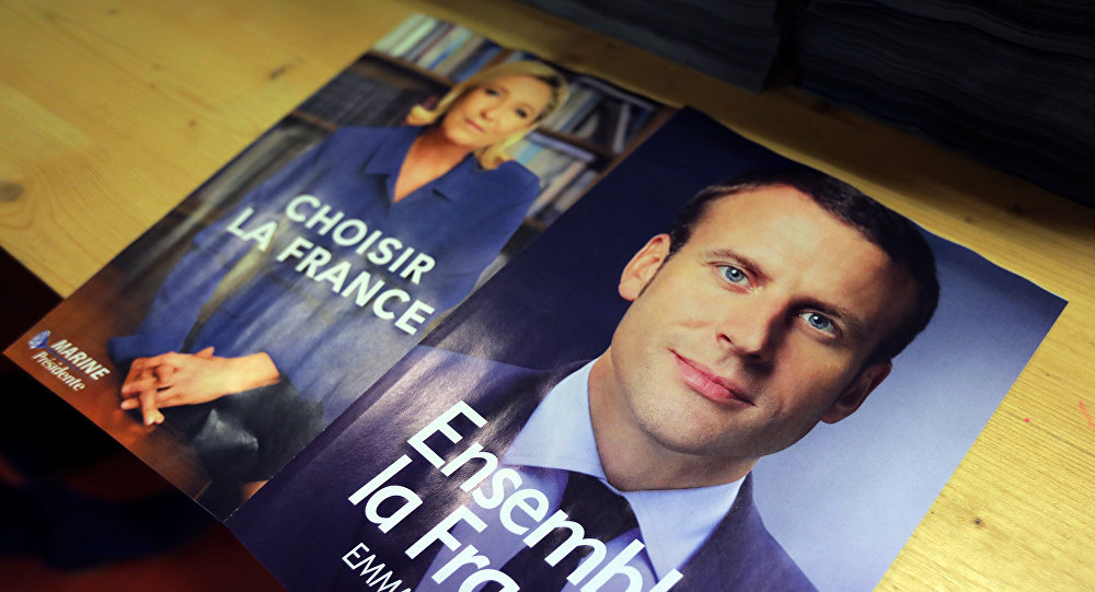 Electoral documents for the upcoming second round of 2017 French presidential election are displayed as registered voters will receive an envelope containing the declarations of faith of each candidate, Emmanuel Macron (R) and Marine Le Pen (L), along with the two ballot papers for the May 7 second round of the French presidential election, in Nice, France, May 3, 2017