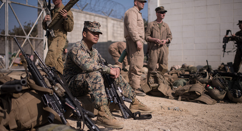 In a photo taken on March 15, 2016 US soldiers of the 13th and 31st Marine Expeditionary Units gather after arriving on shore during a joint military exercise with South Korea entitled 'Ssang Yong', near the southeastern port city of Pohang